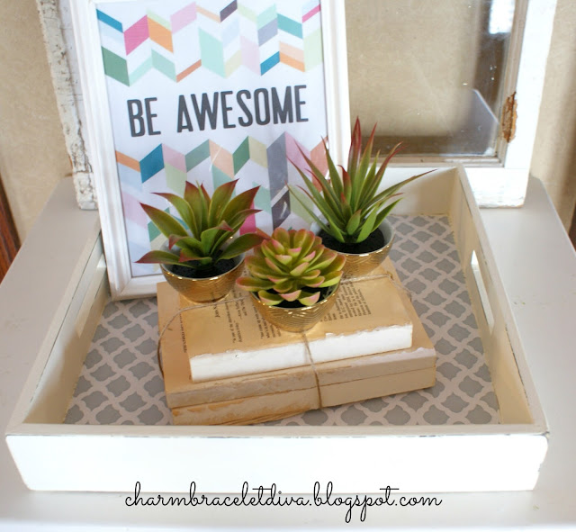 Store cacti in Target golden bowls on book bundles on quatrefoil tray