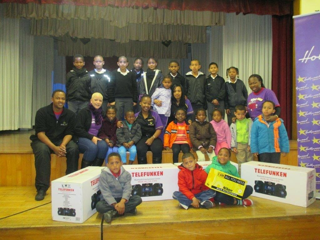 The Hollywoodbets Wynberg Team with children from the Dominican School for the Deaf