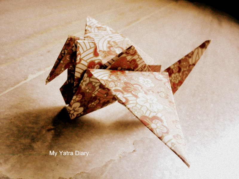 My souvenir of a hand made origami bird - Japan