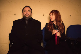 "Mark Sheppard as Crowley and Ruth Connell as Rowena in Supernatural 12x13 ""Family Feud"""