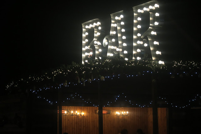 Keep warm with a drink at the bar at Christmas at Beaulieu