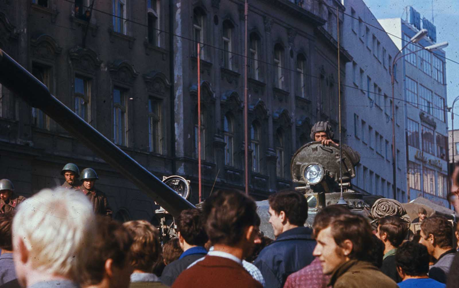 Czechs jeer a Soviet tank in downtown Prague.