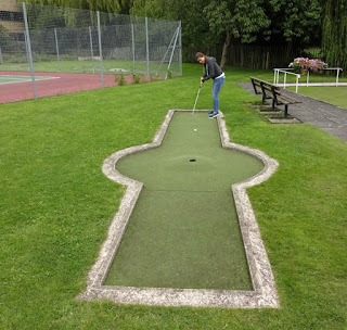 Emily playing the Wellholme Park Crazy Golf course in Brighouse