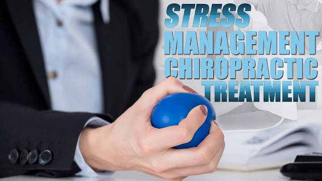 Image of a person holding a stress ball as part of a stress management chiropractic treatment.