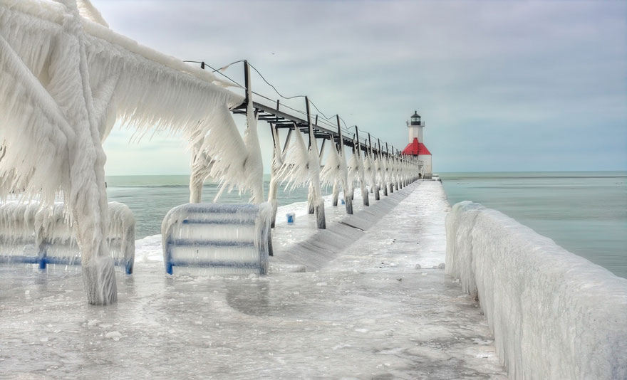 Stunning Frozen Lighthouses Caught In The Winter's Icy Grip On Lake Michigan