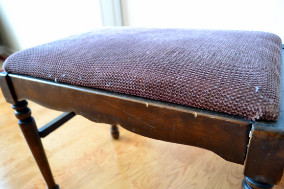 Wooden bench with nicks and scrapes fabric