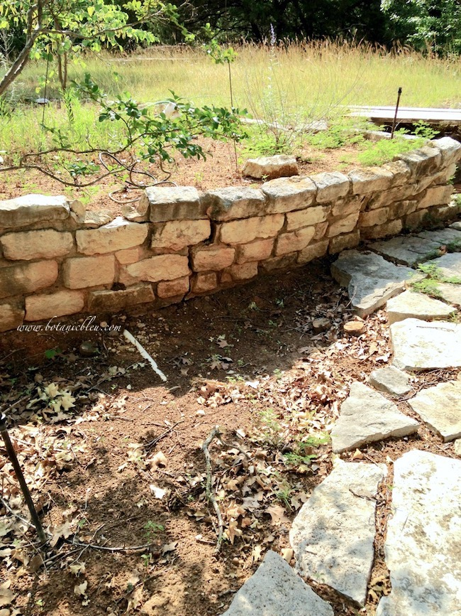 Old Damaged Limestone Wall BEFORE New Gray Paver Block Retaining Wall