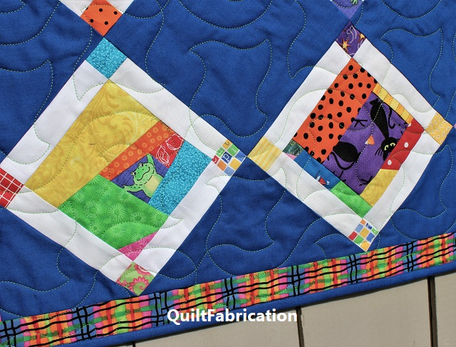 Crumb Jumble quilt with a cat and frog