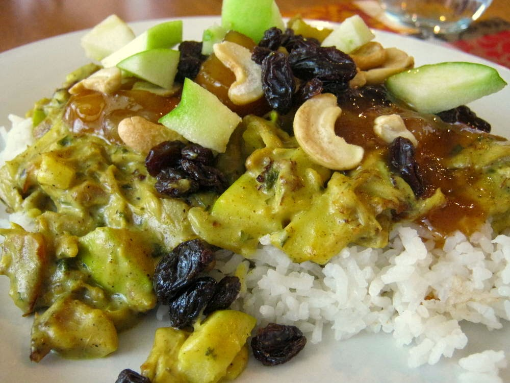 Turkey Curry in a Hurry topped with raisins, cashews, apples, and chutney.