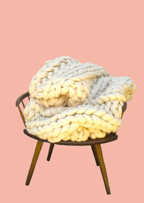 thick knit blankets on a modern chair