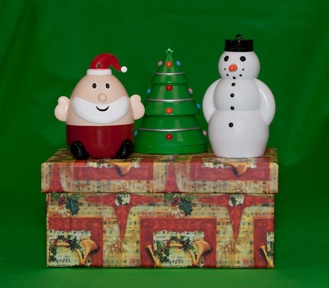Small and simple Christmas ornaments on a box decorated with a Christmas theme.