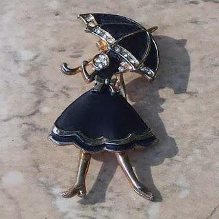 Girl with umbrella brooch 1990s