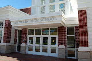 The library is located immediately to the left inside the main entrance at Franklin High School.