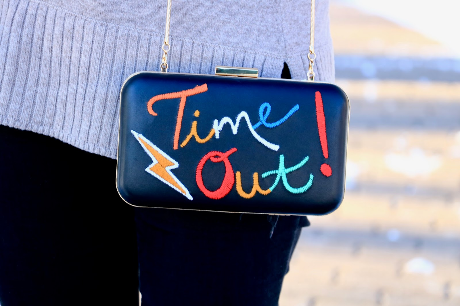 Nyc fashion blogger Kathleen Harper wearing an Alice and Olivia Time Out purse