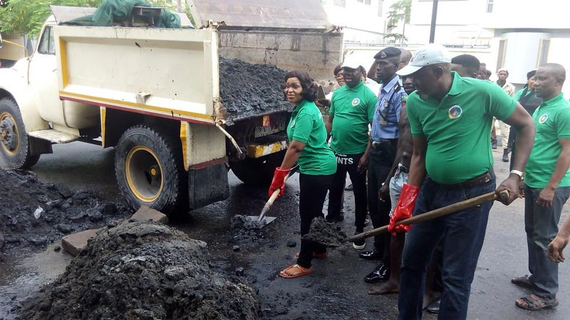 Lagos State administrator seen clearing refuse at monthly sanitation exercise today
