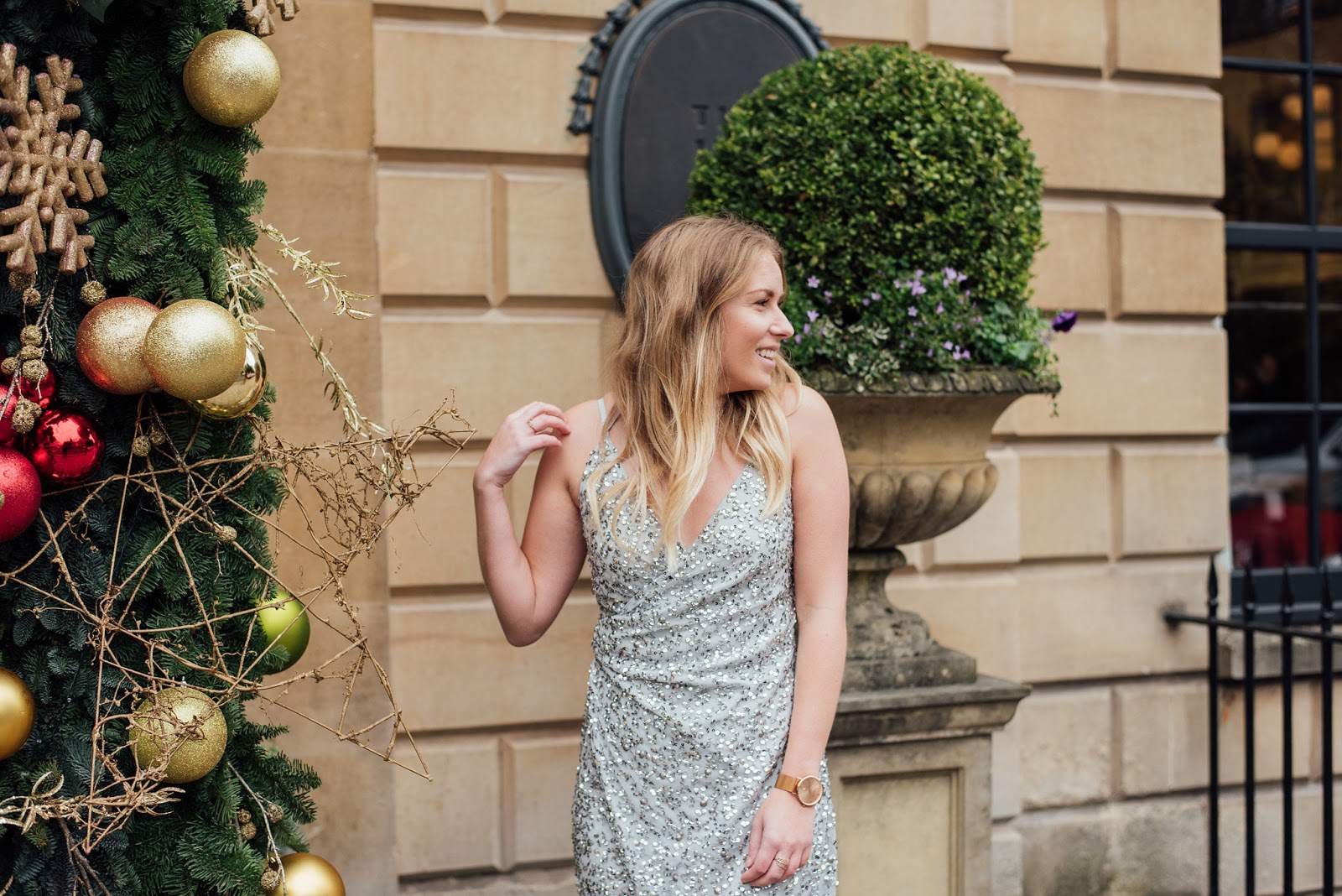 Fashion | The Only Dress You Need For The Christmas Party Season ASOS Silver Sequin Dress, Head Shot next to the christmas decorations