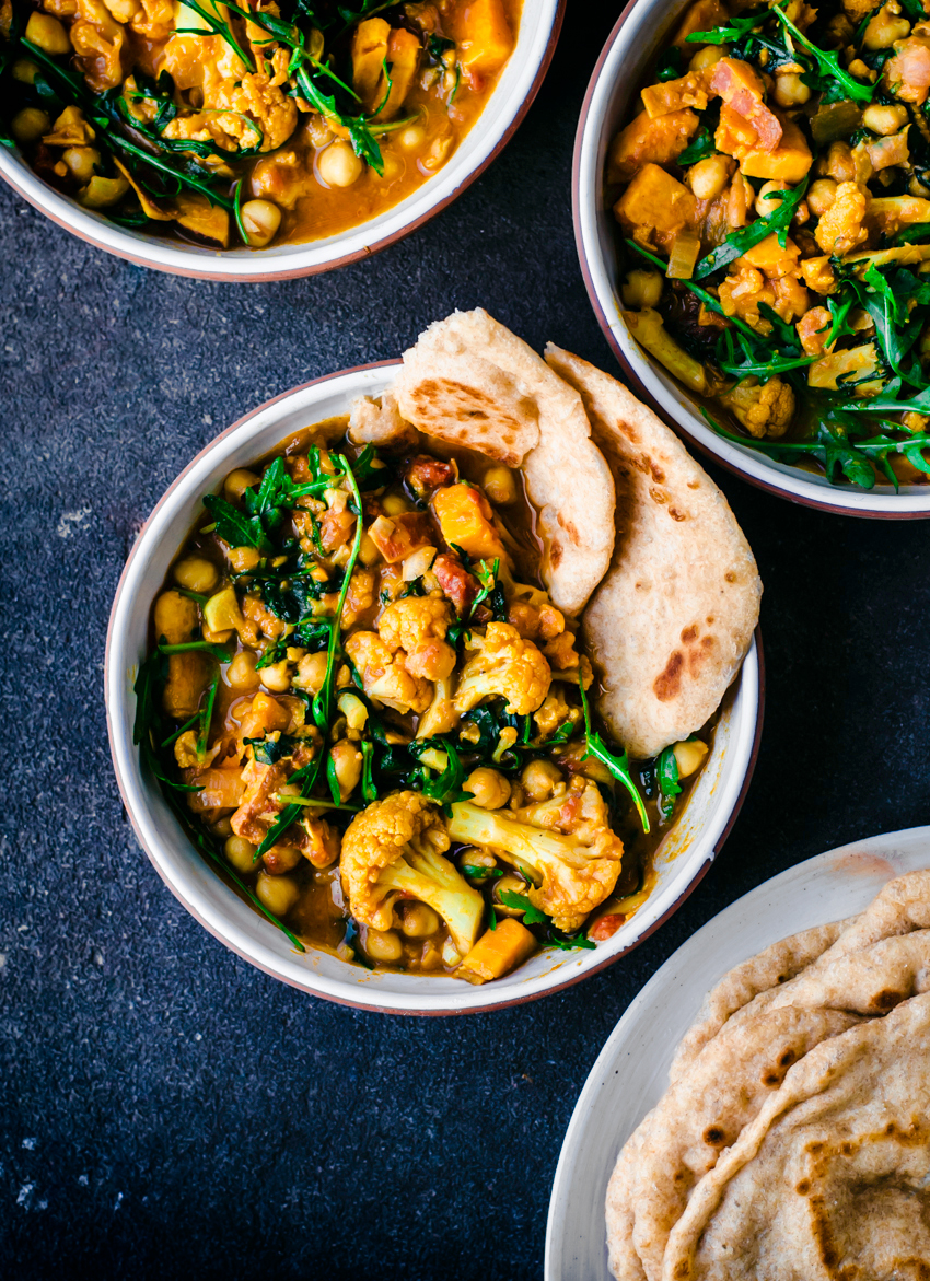 Vegan cauliflower, chickpea, sweet potato, and greens curry for winter
