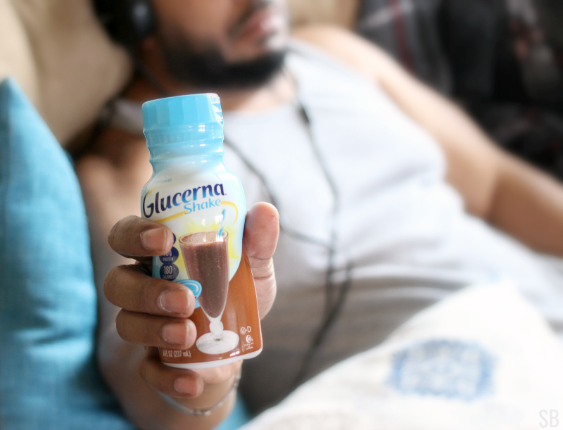 a man holding a Glucerna shake