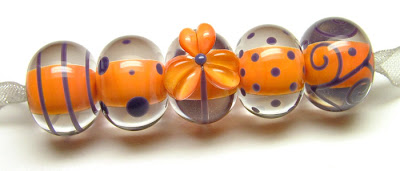 Encased lampwork beads by Laura Sparling