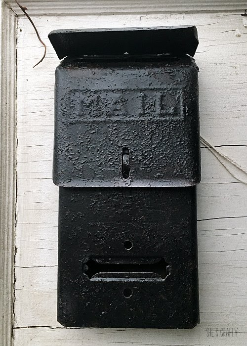 Vintage Mail box repurposed as door hanger for fall flowers