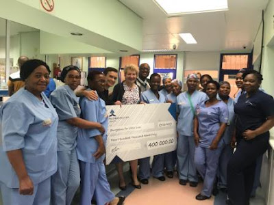 Dr Ronelle Parkhurst, Ms Elsa Taylor, Dr Solly Motuba and staff from CHBAH