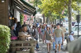 Busy streets of Sag Harbor village, many people walking on sidewalks