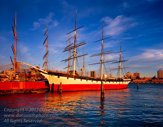 a large format fine art photograph of tall ships at south street seaport in new york city