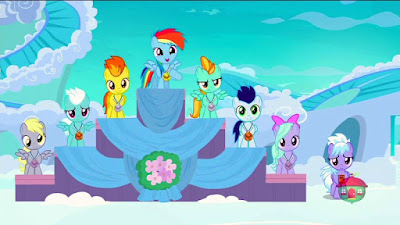 Filly Rainbow Dash stands atop a podium. Lightning Dust, one step down, is not pleased