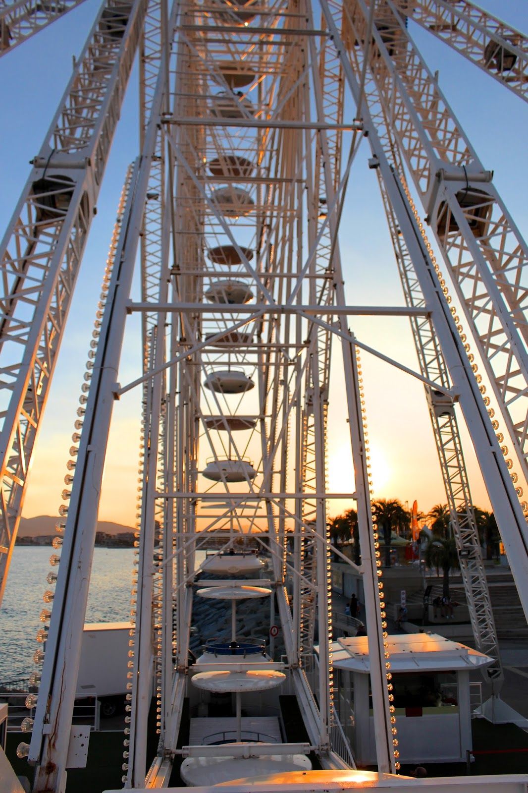 Ferris wheel structure by sunset