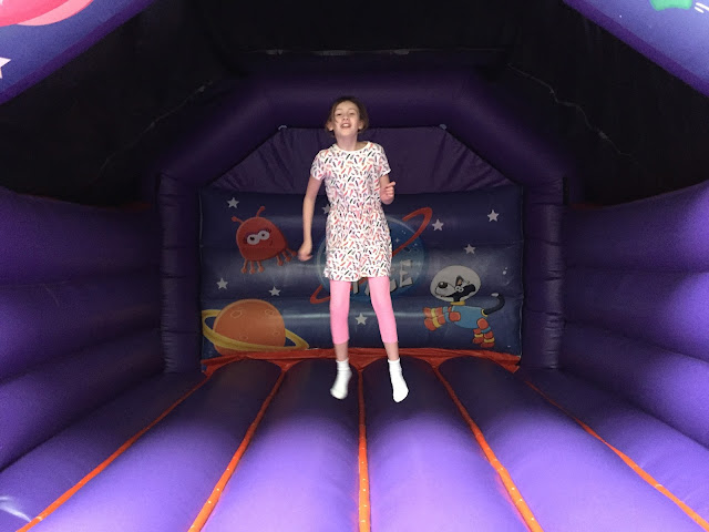 Sasha on bouncy castle