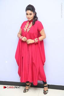 Actress Poorna Latest Stills in Red Dress at Rakshasi First Look Launch  0324.JPG