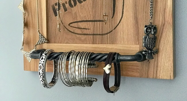 Repurposed cabinet door with hardware for jewelry