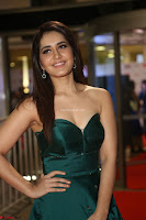 Raashi Khanna in Dark Green Sleeveless Strapless Deep neck Gown at 64th Jio Filmfare Awards South ~  Exclusive 065.JPG