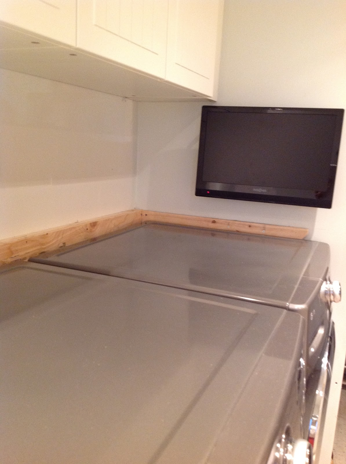 counter over front load washer and dryer, How To Install A Countertop Over A Washer And Dryer, DIY floating countertop in the laundry room, countertop cleat