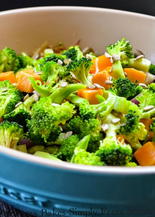 Broccoli Salad recipe with sesame seed dressing, bell pepper, cheddar cheese, and sunflower seeds is always devoured fast. Delicious recipe from Serena Bakes Simply From Scratch.