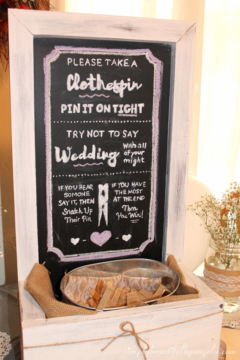 a table that had a diy chalkboard that explained the infamous clothespin game and a big initial where they could sign their well wishes to the bride