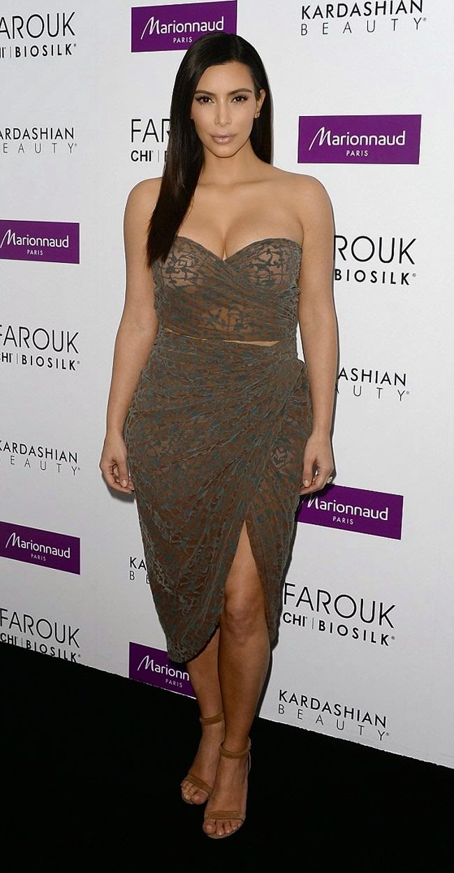 Kim Kardashian Displays Plenty of Cleavage in a Semi-Sheer Bandeau Wrap Dress