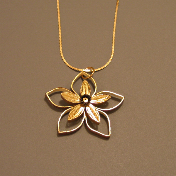 golden quilled paper double flower pendant on a gold necklace chain