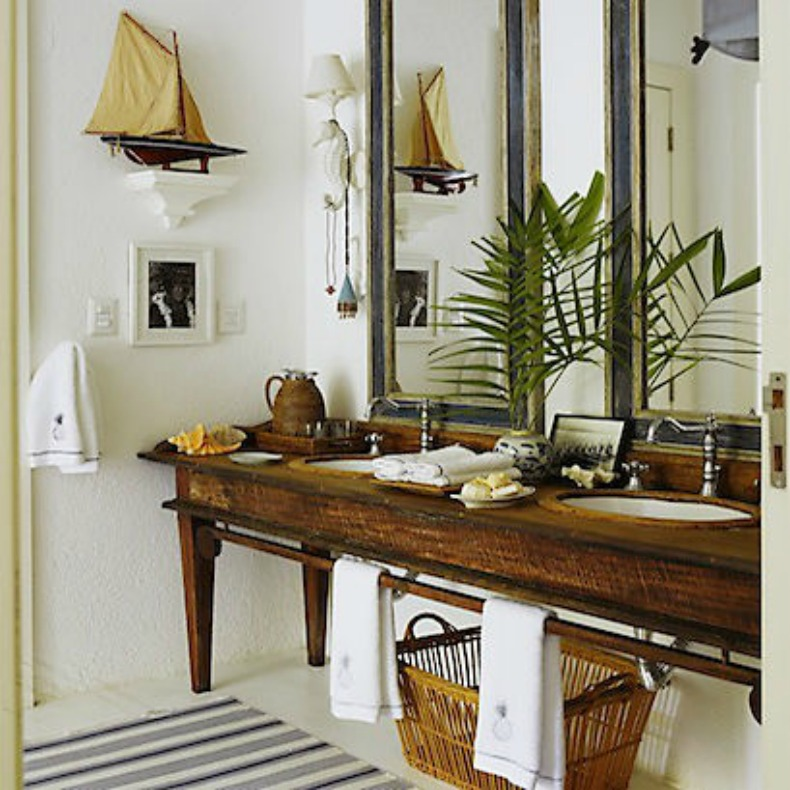 Coastal bathroom with rich woods, bright white walls and nautical touches