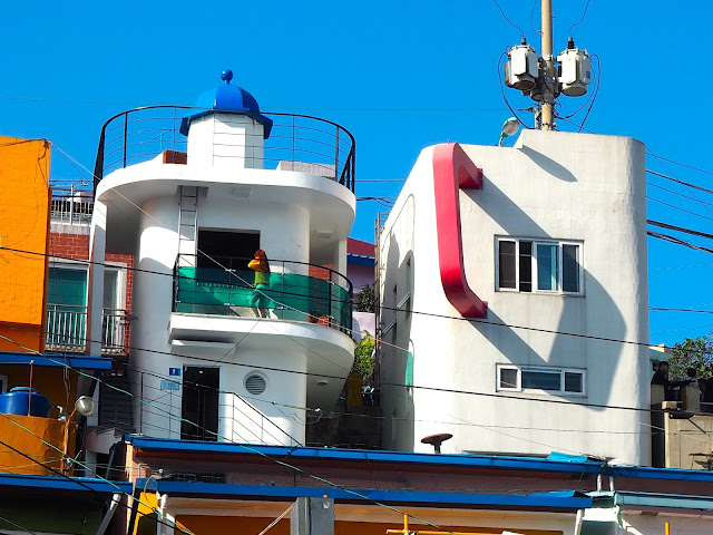 Lighthouse photo zone building and Book Cafe, building shaped like a mug, in Gamcheon Village, Busan, South Korea
