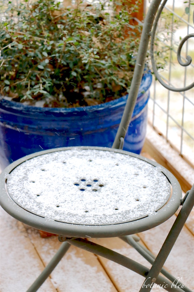 snow-covered-metal-chair