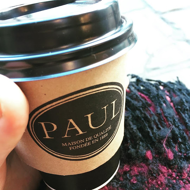 Hot Chocolate from Paul's Bakery, drunk in Covent Garden with a cosy scarf behind it