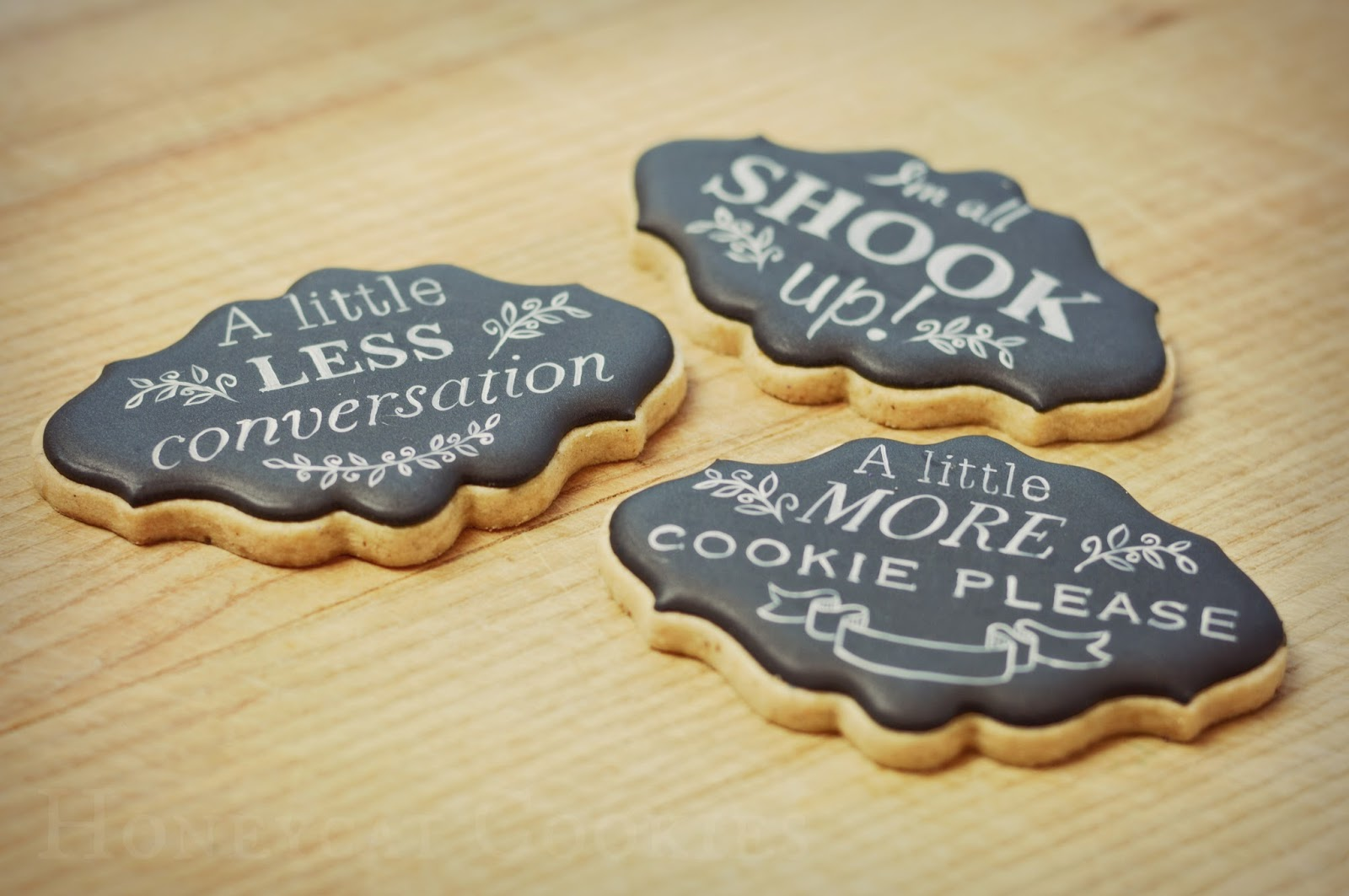 Chalkboard cookies with handpainted Elvis quotations by Honeycat Cookies.