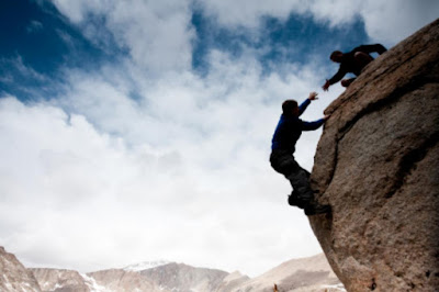 asking-for-healp-oneperson-giveng-hand-to-other-preventing-him-falling-from-mountain-http://www.woobleweb.com/