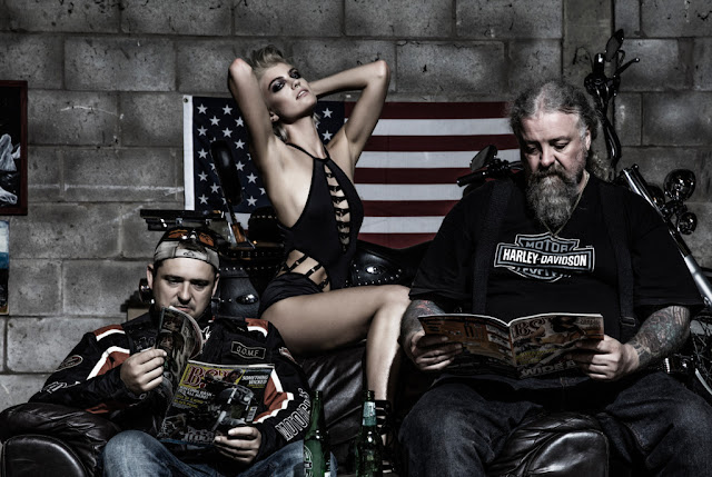 Lingerie model poses with two bikers reading BSH magazine
