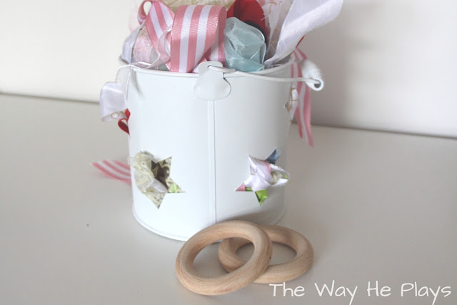 Container of ribbons and two wooden curtain rings