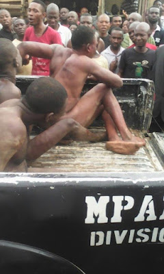 Photos: Robbers stripped and flogged by residents after breaking into a shop in Abuja