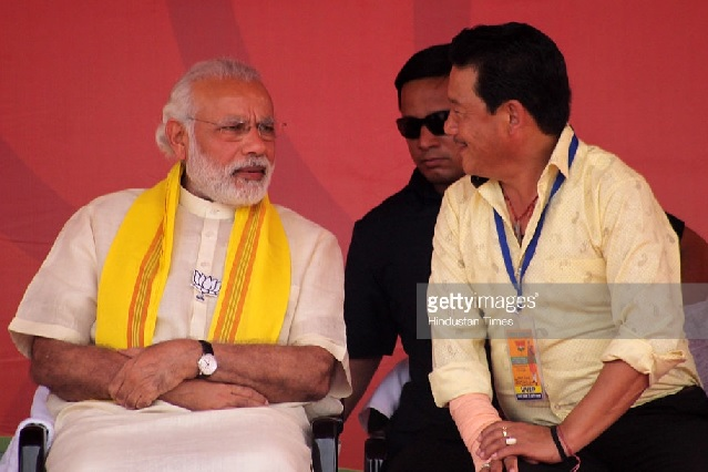 Prime Minister Narendra Modi with Gorkha Jan Mukti Morcha Chief Bimal Gurung during the BJP election campaign rally at Birpara on April 7, 2016 in Dooar