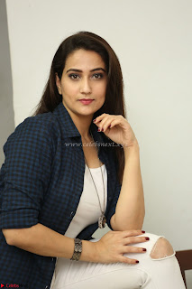 Manjusha in White Tight T Shirt and Black Jacket ~  Exclusive Celebrities Galleries 002.JPG