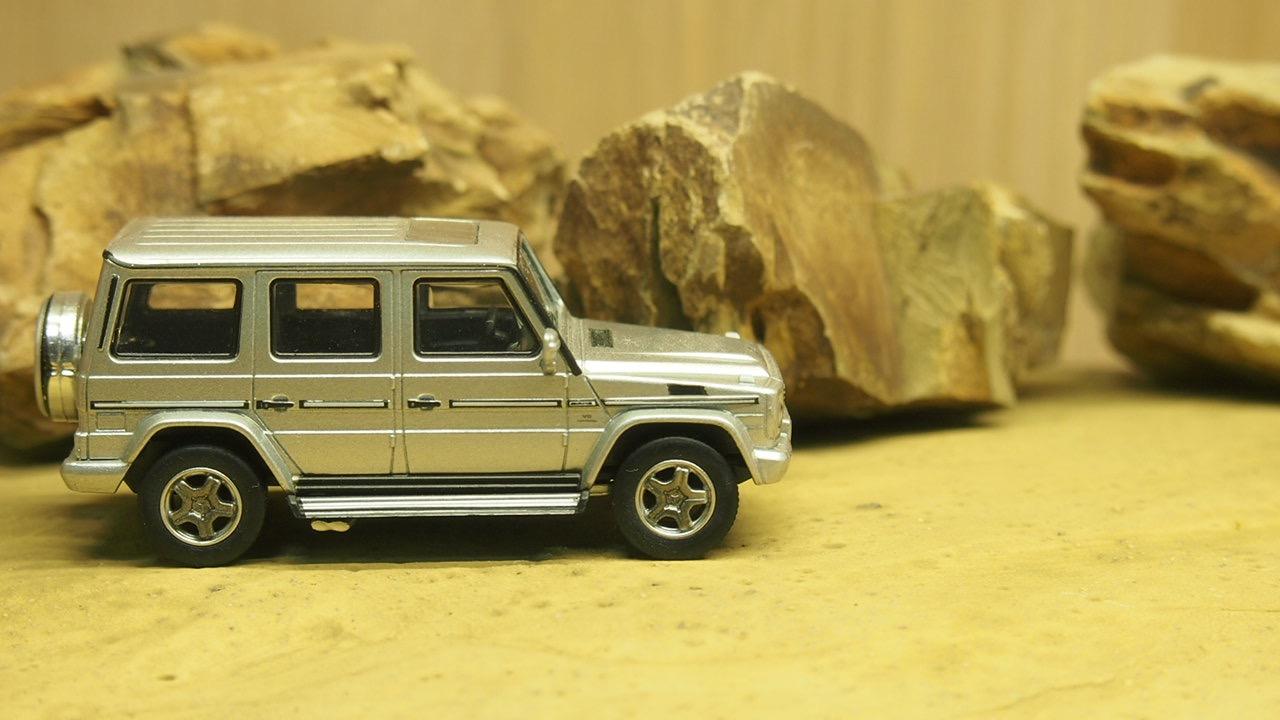 Mercedes-Benz AMG g55 g 55 negro en acrylbox 1:64 Kyosho
